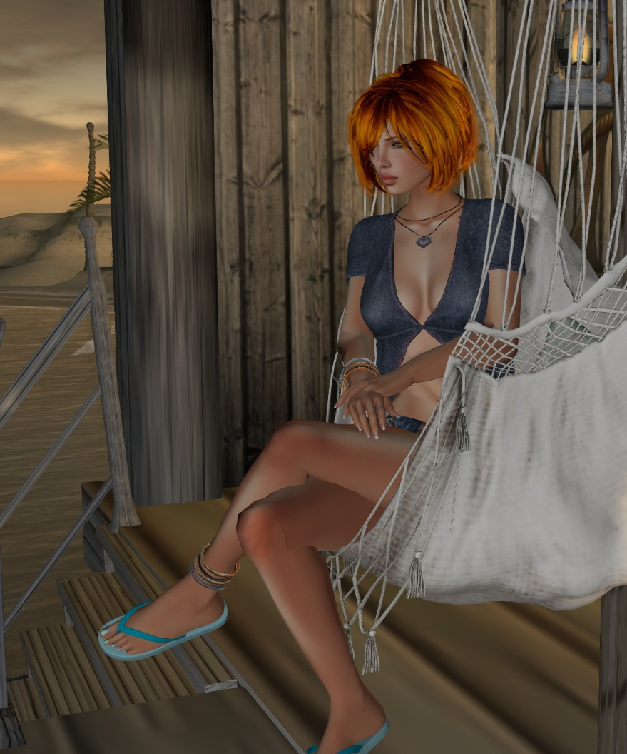 blue sitting in a hammok chair
