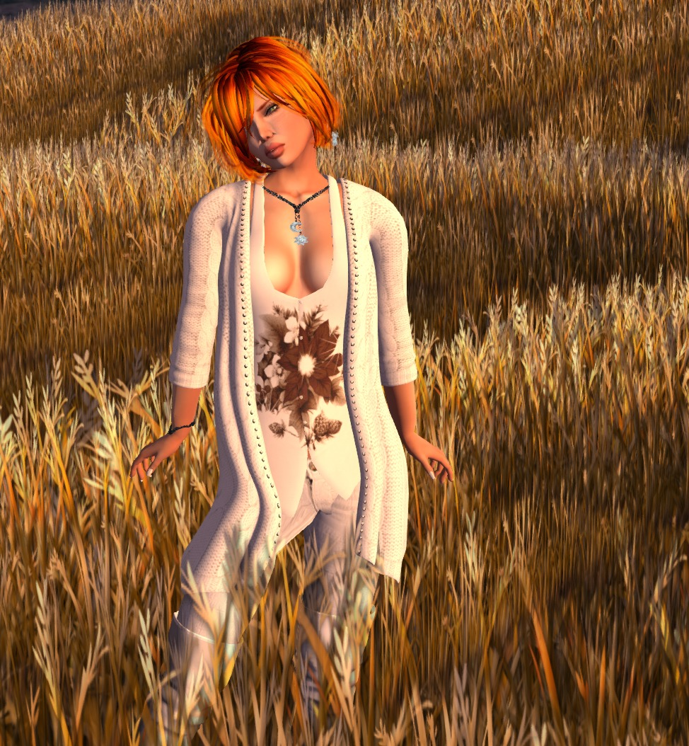 blue in a white cardigan and vest in a wheat field